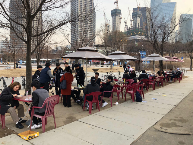The chairs and table right beside Mini Stop at Yeoido Hangang Park